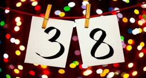 The number 38 displayed with lights in the background.