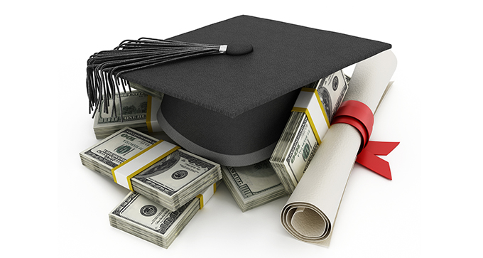 Graduate's mortarboard on top of stacks of cash and a diploma