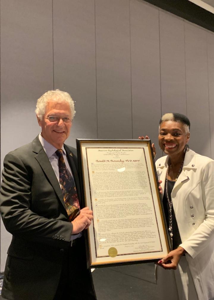 Rosie Phillips Davis presents Raymond D. Fowler Award to Ronald Rozensky
