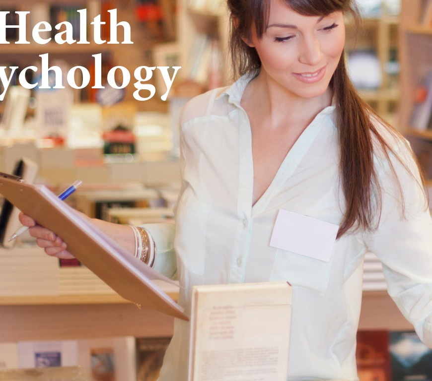Woman with clipboard looking at books in bookstore with the words Health Psychology displayed