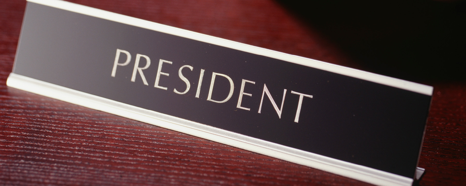 desk sign saying president
