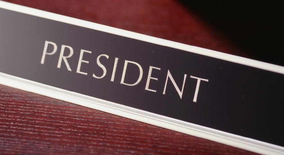 desk sign saying president